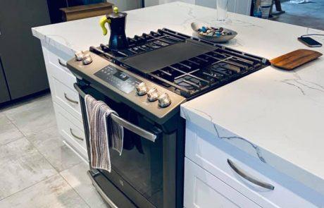 black stove in a white kitchen